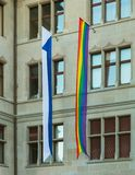 Facade of the Zurich City Hall decorated with flags of Zurich and the LGBT movement. Zurich, Switzerland - June 16, 2019: facade of the Zurich City Hall building stock images