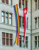 Facade of the Zurich City Hall decorated with flags of Switzerland and the LGBT movement. Zurich, Switzerland - June 16, 2019: facade of the Zurich City Hall stock image