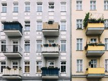 Facades of altbau buildings in Penzlauer Berg, Berlin. Grey and yellow facades of apartment buildings with balconies in Penzlauer Berg, Berlin Royalty Free Stock Photo
