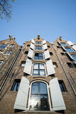 Facades of amsterdam with shutters Stock Photo