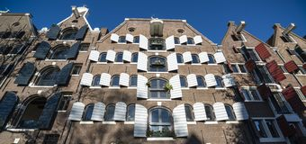 Facades of amsterdam with shutters Stock Photography