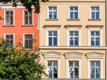 Facades of ancient tenements Stock Images