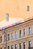 Facades of apartment buildings. Facades of two separate apartment buildings with different number of windows, St. Petersburg, Russia Royalty Free Stock Photo