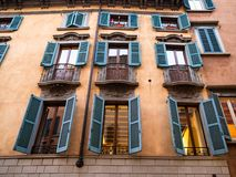 facades of apartment medieval houses in Bergamo stock photography