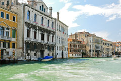 Facades of buildings along venetian canal Stock Images