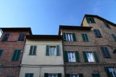 Facades of buildings in Siena Stock Photos