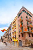 Facades decorated with flags of  Tarragona and Catalonia Royalty Free Stock Image