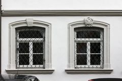 facades with doors and windows or ornaments on buildings of a hi stock image