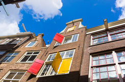 Facades of houses in old city in Amsterdam Stock Photography