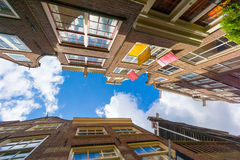 Facades of houses in old city in Amsterdam Royalty Free Stock Photography