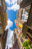 Facades of houses in old city in Amsterdam Royalty Free Stock Image