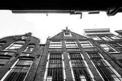 Facades of houses in old city in Amsterdam Royalty Free Stock Images