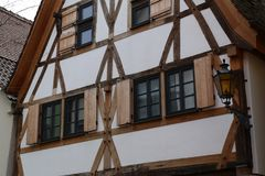 Facades of houses in the old style. Tudor style house. Facades of houses in the old style royalty free stock images