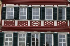 Facades of houses in the old style. Tudor style house. Facades of houses in the old style royalty free stock image