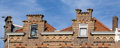 Facades of houses in street Noordendijk, Dordrecht, The Netherlands royalty free stock photos