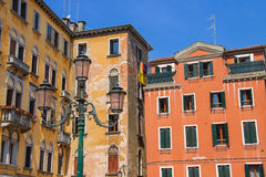 Facades of houses on a street in Venice Stock Image