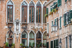 Facades of houses on a street in Venice, Italy Royalty Free Stock Images
