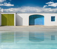 Facades of houses with white wall Royalty Free Stock Image