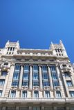 Facades of Madrid. View in perspective of a building in Gran Via street, Madrid, Spain Royalty Free Stock Photo