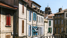 facades of old apartment houses in Arles city Stock Images