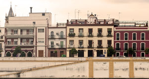Facades of old houses. In various colors lying about the other aldo in the Spanish city of Seville Stock Image