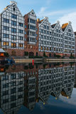 Facades of old houses with reflection in water Motlawa river, Gd Stock Photos