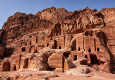 Facades of old sandstone houses. Petra, Jordan. Stock Photos