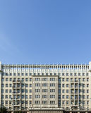 Facades of old socialist GDR era apartment buildings on Karl Mar Stock Images