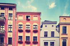 Facades of old tenement houses. Stock Photo