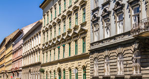Facades. The facades of a row of old apartment buildings in Budapest, Hungary Royalty Free Stock Photos