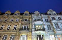 Facades of tenement houses with balconies during the night Royalty Free Stock Photos