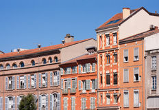 Facades of Toulouse. Facades of the St. Etienne square in Toulouse, France Stock Image