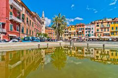Facades and tower bell in the main square of Lerici, Liguria - Italy Royalty Free Stock Photos