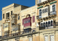 Facades And Traditional Balconies In Valletta. Luxury mansions baroque style with the traditional balconies wooden in a Valletta street, Malta Royalty Free Stock Photography