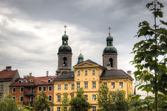 Facades of typical houses and cathedral in Innsbruck, Austria Royalty Free Stock Photography