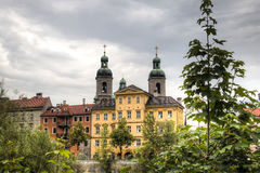 Facades of typical houses and cathedral in Innsbruck, Austria Stock Images