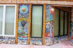 Facades, walls decorated with colorful mosaic design throughout the building at Pha Sorn Kaew, Khao Kor, Phetchabun, Thailand. Facades, walls decorated with royalty free stock image