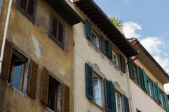 Facades with wooden window shutters in Florence, Italy Royalty Free Stock Images