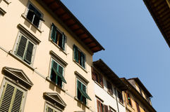 Facades with wooden window shutters in Florence, Italy Stock Images
