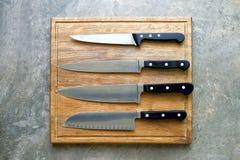 Facas de cozinha ajustadas, configuração do plano Foto de Stock Royalty Free