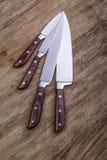 Facas de cozinha em de madeira Foto de Stock Royalty Free