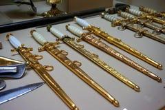 Facas douradas pequenas Imagens de Stock