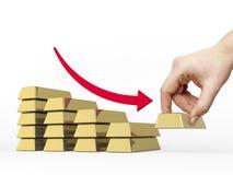 Faccia diminuire il diagramma a colonna fatto delle barre dorate Fotografia Stock