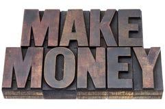 Faccia i soldi nel tipo di legno Immagini Stock