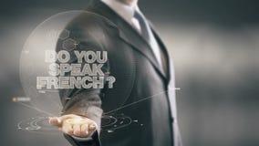 Faccia il vostro parlano le nuove tecnologie disponibile di Holding dell'uomo d'affari francese Immagine Stock