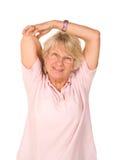 Faccia maturare l'allungamento della signora più anziana Fotografie Stock Libere da Diritti