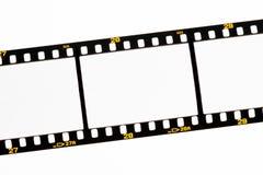 Faccia scorrere le strisce della pellicola con i blocchi per grafici vuoti Fotografia Stock Libera da Diritti