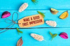 Faccia un buon testo della prima impressione sull'etichetta di carta fotografia stock libera da diritti