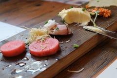 Faccia un spuntino l'aperitivo delle verdure, del pesce, del pane e del burro Fotografie Stock