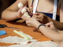 Faccia una bambola di straccio Fotografia Stock Libera da Diritti